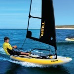 man racing on sea in a tiwal inflatable racing dinghy