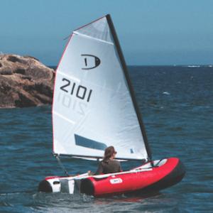 a woman sailing dinghygo on the sea