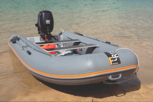 F-RIB 360 on beach in Salcombe, Tohatsu 20 on transom. Fast, comfortable transport for loads up to 700kg. This model has two bench seats.