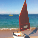 Tender to Mischief (Pilot Cutter in background). This Nestaway 8ft two-section Pram dinghy has the optional 36 square foot balanced lugsail rig.