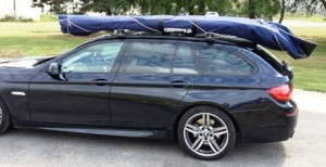 Nautiraid coracle on estate car roof rack