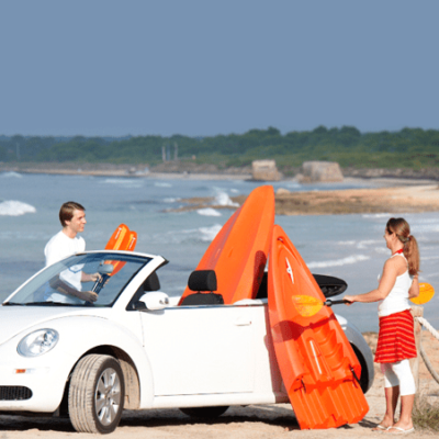 tequila kayak sectional point 65 on beach in a car