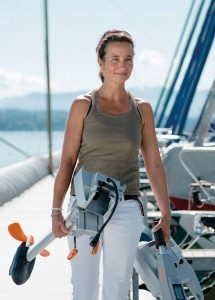 woman carrying outboards parts